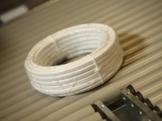 Flat cable coil